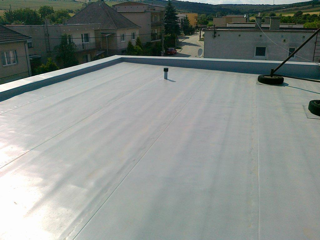 Adhesive roof